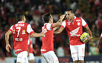 BOGOTA- COLOMBIA -16 -04-2014: Wilder Medina (Der.) jugador de Independiente Santa Fe, celebra el gol anotado a Universidad Autonoma durante partido aplazado entre Independiente Santa Fe y Universidad Autonoma por la fecha 16 entre de la Liga Postobon I 2014, jugado en el estadio Nemesio Camacho El Campin de la ciudad de Bogota.  / Wilder Medina, (R) player of Independiente Santa Fe, celebrates a goal scored to Universidad Autonoma during a postponed match between Independiente Santa Fe and Universidad Autonoma for the date 16th of the Liga Postobon I 2014 at the Nemesio Camacho El Campin Stadium in Bogota city. Photo: VizzorImage / Luis Ramirez / Staff.