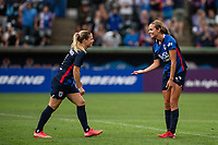 TACOMA, WA - JULY 31: Dani Weatherholt #17 and Eugenie Le Sommer #9 of the OL Reign celebrate a goal during a game between Racing Louisville FC and OL Reign at Cheney Stadium on July 31, 2021 in Tacoma, Washington.