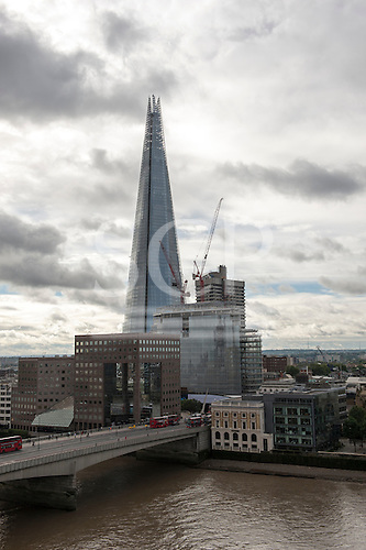 London, England. The Shard and other modern buildings by London bridge.