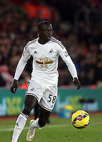Pictured: Modou Barrow of Swansea Sunday 01 February 2015<br />