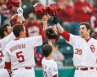 Oklahoma team celebrates at home after Tyler Ogle (35) home run late in late innings during the NCAA matchup between the University of Arkansas-Little Rock Trojans and the University of Oklahoma Sooners at L. Dale Mitchell Park in Norman, Oklahoma; March 11th, 2011.  Oklahoma won 11-3.  Photo by William Purnell/Four Seam Images