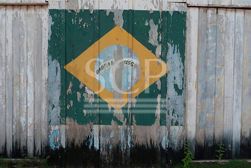 Novo Progresso, Para State, Brazil. Faded painted Brazilian flag on a wooden wall.