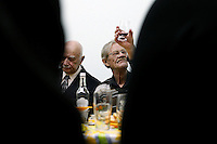 World War II veterans and other Chernobyl plant retirees gather in Slavutych, Ukraine, to observe Red Army Day, a holiday originally dedicated to veterans of the Russian and Soviet Armed Forces.  <br /> ------------------- <br /> This photograph is part of Michael Forster Rothbart's After Chernobyl documentary photography project.<br /> © Michael Forster Rothbart 2007-2010.<br /> www.afterchernobyl.com<br /> www.mfrphoto.com <br /> 607-267-4893 o 607-432-5984<br /> 5 Draper St, Oneonta, NY 13820<br /> 86 Three Mile Pond Rd, Vassalboro, ME 04989<br /> info@mfrphoto.com<br /> Photo by: Michael Forster Rothbart<br /> Date:  2/2009    File#:  Canon 5D digital camera frame 60662<br /> ------------------- <br /> Original caption: .In Slavutych, Ukraine, members of the Nezdaiomtsya pensioners' group gather to observe Red Army Day, a holiday originally dedicated to veterans of the Russian and Soviet Armed Forces. Today, the holiday is officially called Defender of the Fatherland Day, but colloquially it is simply called Men's Day (???? ??????)...Most members of Nezdaiomtsya are Chernobyl retirees. Both men pictured here are World War II veterans. Slavutych is the new city built after the Chernobyl accident to replace the abandoned city of Pripyat. After the April 26, 1986 accident at the Chernobyl Nuclear Power Plant, the population within 30 kilometers was permanently evacuated, including residents of Pripyat and many villages. .-------------------.