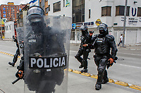 BOGOTA, COLOMBIA - APRIL 28 : National police officers take position during a national strike Against the Duque package and the tax reform on April 28, 2021 in Bogota, Colombia. Colombia has the minimum wage around $ 250 per month where people are unhappy about corruption, unemployment, and inequality by Government. (Photo by Leonardo Munoz/VIEWpress)
