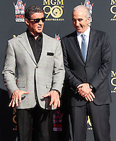 HOLLYWOOD, CA - JANUARY 22: Sylvester Stallone, Gary Barber at the Metro-Goldwyn-Mayer 90th Anniversary Celebration held at the TCL Chinese Theatre on January 22, 2014 in Hollywood, California. (Photo by Xavier Collin/Celebrity Monitor)