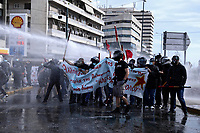 Pictured: Anti-Israel protesters are targeted by a water canon in Athens, Greece. Saturday 15 May 2021<br /> Re: Palestinian people living in Greece, joined by local supporters protesting against Israel, have clashed with police in central Athens, Greece.