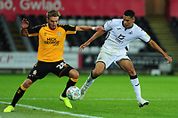 Sam Smith of Cambridge United vies for possession with Ben Cabango of Swansea City during the Carabao Cup Second Round match between Swansea City and Cambridge United at the Liberty Stadium in Swansea, Wales, UK. Wednesday 28, August 2019.