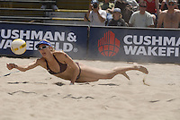 Huntington Beach, CA - 5/5/07:   Kerri Walsh dives for the ball during May-Treanor / Walsh's 21-14, 21-12 victory over McPeak / Tom Saturday during the 2007 AVP CROCS Tour in Huntington Beach..Photo by Carlos Delgado