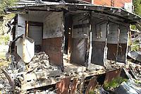 The crumbling bathroom at one of the Kennicott Mine barracks.