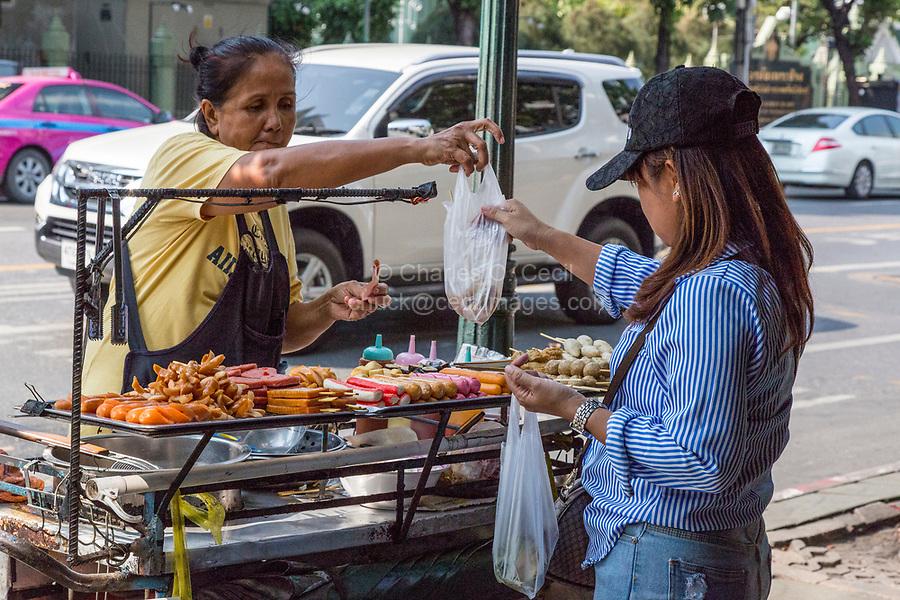 Bangkok, Thailand.  Street Food Vendor Offering Kebabs, Hot Dogs, Roasted Meats.