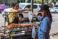 Bangkok, Thailand.  Street Food Vendor Offering Kebabs, Hot Dogs, Roasted Meats.