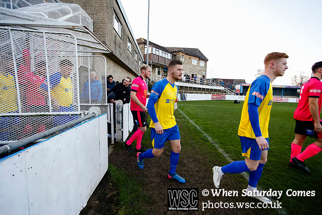The teams enter the pitch. Stocksbridge Park Steels v Pickering Town, Evo-Stik East Division, 17th November 2018. Stocksbridge Park Steels were born from the works team of the local British Steel plant that dominates the town north of Sheffield.<br /> Having missed out on promotion via the play offs in the previous season, Stocksbridge were hovering above the relegation zone in Northern Premier League Division One East, as they lost 0-2 to Pickering Town. Stocksbridge finished the season in 13th place.