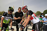 Robbie McEwen (AUS) GreenEdge Cycling Team and Radioshack-Nissan Trek rider Fabian Cancellara (SUI) chat at sign on before the start of the 3rd Stage of the 2012 Tour of Qatar running 146.5km from Dukhan Souq, Dukhan to Al Gharafa, Qatar. 7th February 2012.<br /> (Photo Eoin Clarke/Newsfile)