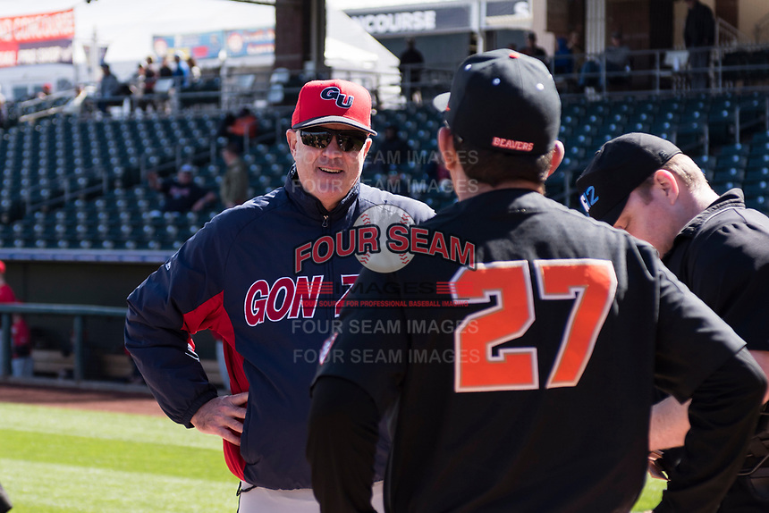 Gonzaga Bulldogs head coach Mark Machtolf meets with Oregon State head coach Pat Bailey (27) before a game on February 16, 2019 at Surprise Stadium in Surprise, Arizona. Oregon State defeated Gonzaga 9-3. (Zachary Lucy/Four Seam Images)