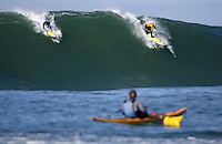 Peter Mel (blue) and Tyler Smith (yellow) split a peak during the fourth heat of the 2008 Mavericks contest held at Pillar Point, Half Moon Bay, Calif., Saturday, January 12, 2008.