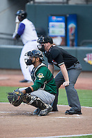 Lynchburg Hillcats catcher Alex Monsalve (48) gives his pitcher a sign as home plate umpire Chase Eade looks on during the Carolina League game against the Winston-Salem Dash at BB&T Ballpark on May 29, 2015 in Winston-Salem, North Carolina.  The Dash defeated the Hillcats 8-1.  (Brian Westerholt/Four Seam Images)