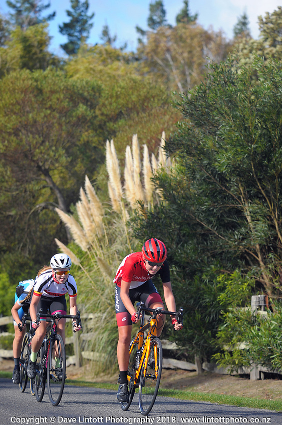 Rhylee Akeroyd (left) and Erin Downie (u17 girls). Millars Road circuit race on day two of the 2018 NZ Age Group Road Cycling Championships in Carterton, New Zealand on Saturday, 21 April 2018. Photo: Dave Lintott / lintottphoto.co.nz