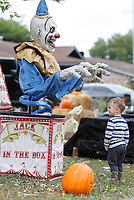 Noah Bohannan, 2, reacts Thursday, October 15, 2020, to Halloween decorations at a home on Backus Avenue in Springdale. Julie Farr, babysitter, said that visiting the decorated house is a favorite activity of Noah's and he likes to talk to the different characters. Check out nwaonline.com/201016Daily/ and nwadg.com/photos for a photo gallery.(NWA Democrat-Gazette/David Gottschalk)