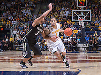 California's Justin Cobbs  drives around Colorado's Xavier Talton into the paint during a game at Haas Pavilion in Berkeley, California on March 8th, 2014. California defeated Colorado 66 - 65