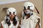 Two of the Tongva Nation Dancers pose in their dance regalia at Moompetam at te Aquarium of the Pacific in Long Beach, CA