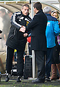 FOURTH OFFICIAL IAIN BRINES AND HEARTS MANAGER PAULO SERGIO SHAKE HANDS AT THE START OF THE GAME