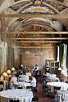 Patrons take lunch at the La Veranda de'lHotel Columbus in a hall frescoed by the Italian renaissance artist Pinturicchio near St. Peters Cathederal.