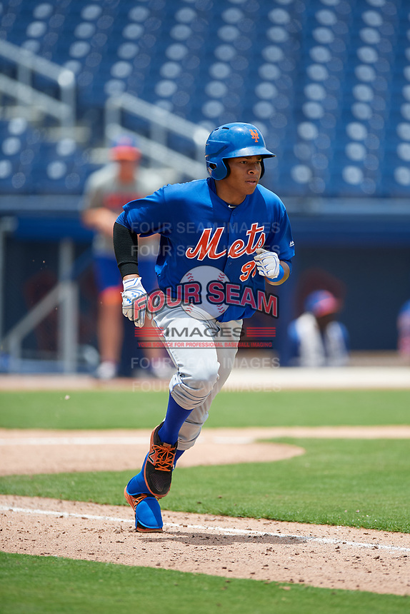 GCL Mets center fielder Guillermo Granadillo (90) runs to first base during the second game of a doubleheader against the GCL Nationals on July 22, 2017 at The Ballpark of the Palm Beaches in Palm Beach, Florida.  GCL Mets defeated the GCL Nationals 4-1.  (Mike Janes/Four Seam Images)