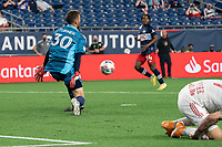 FOXBOROUGH, MA - MAY 22: Matt Turner #30 of New England Revolution faces  a shot on goal during a game between New York Red Bulls and New England Revolution at Gillette Stadium on May 22, 2021 in Foxborough, Massachusetts.