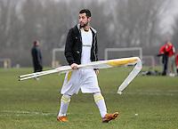 A Baris Spor player carries the corner flags - Baris Spor (white) vs Florist Arms - Hackney & Leyton League at South Marsh, Hackney - 07/02/10 - MANDATORY CREDIT: Gavin Ellis/TGSPHOTO - Self billing applies where appropriate - Tel: 0845 094 6026