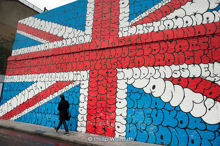 Wall painting of a Union Jack at Village Underground, a renovated warehouse containing a non-profit gallery, club space and creative studios in Shoreditch, London, a run-down commercial district  also known as Silicon Roundabout, which is undergoing gentrification as it becomes a centre for web-based companies and IT start-ups.
