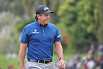 Feb 22, 2009: Victory is close as Phil Mickelson marches on the 18th green at the Northern Trust Open 2009 in the Pacific Palisades, California.