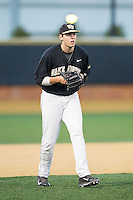 Wake Forest Demon Deacons third baseman Will Craig (22) on defense against the Missouri Tigers at Wake Forest Baseball Park on February 22, 2014 in Winston-Salem, North Carolina.  The Demon Deacons defeated the Tigers 1-0.  (Brian Westerholt/Four Seam Images)