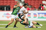 Dylan Sage of South Africa (right) tries to tackle Setareki Bituniyata of Fiji during the match Fiji vs South Africa, Day 2 of the HSBC Singapore Rugby Sevens as part of the World Rugby HSBC World Rugby Sevens Series 2016-17 at the National Stadium on 16 April 2017 in Singapore. Photo by Victor Fraile / Power Sport Images