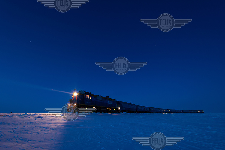 A train travels along the Obskaya-Bovanenkovo railway. It is the northernmost railway in the world, built on the permafrost of the Yamal Peninsula above the Arctic Circle.The railway provides year-round delivery of equipment, building materials and transportation of shift workers to the Gasprom Bovanenkovo gas field.