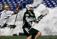 Cooper MacDonnell (16) of Loyola drives past  Ian Crumley (34) of Navy at the Navy-Marine Corp Memorial Stadium in Annapolis, Maryland.   Loyola defeated Navy, 8-7, in overtime.