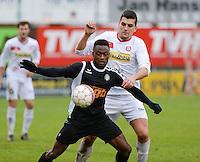 FC Gullegem - Racing Gent Zeehaven : duel om de bal tussen Glory Monday Ajayi (links) en Jenci Dejonghe (r) <br /> Foto VDB / Bart Vandenbroucke