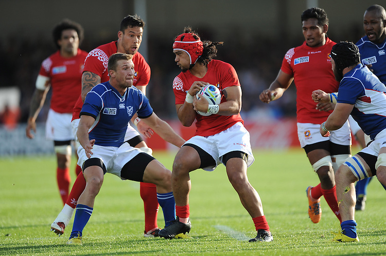 Latiume Fosita of Tonga braces himself for the tackle of Johan Tromp of Namibia during Match 20 of the Rugby World Cup 2015 between Tonga and Namibia - 29/09/2015 - Sandy Park, Exeter<br /> Mandatory Credit: Rob Munro/Stewart Communications