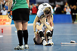 Leipzig, Germany, February 08: Franzisca Hauke #21 of Germany is hugged by Katharina Windfeder #5 of Germany after missing a penalty during shoot-out during the women gold medal match between Germany (white) and The Netherlands (orange) on February 8, 2015 at the FIH Indoor Hockey World Cup at Arena Leipzig in Leipzig, Germany. Final score 1-2 after shoot out (1-0, 1-1). (Photo by Dirk Markgraf / www.265-images.com) *** Local caption ***