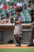 Pensacola Blue Wahoos catcher Chris Okey (5) in front of home plate umpire Reid Joyner during a game against the Birmingham Barons on May 9, 2018 at Regions Field in Birmingham, Alabama.  Birmingham defeated Pensacola 16-3.  (Mike Janes/Four Seam Images)