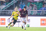 AC Milan Defender Gustavo Gomez (R) dribbles Borussia Dortmund Midfielder Andre Schurrle (L) in action during the International Champions Cup 2017 match between AC Milan vs Borussia Dortmund at University Town Sports Centre Stadium on July 18, 2017 in Guangzhou, China. Photo by Marcio Rodrigo Machado / Power Sport Images