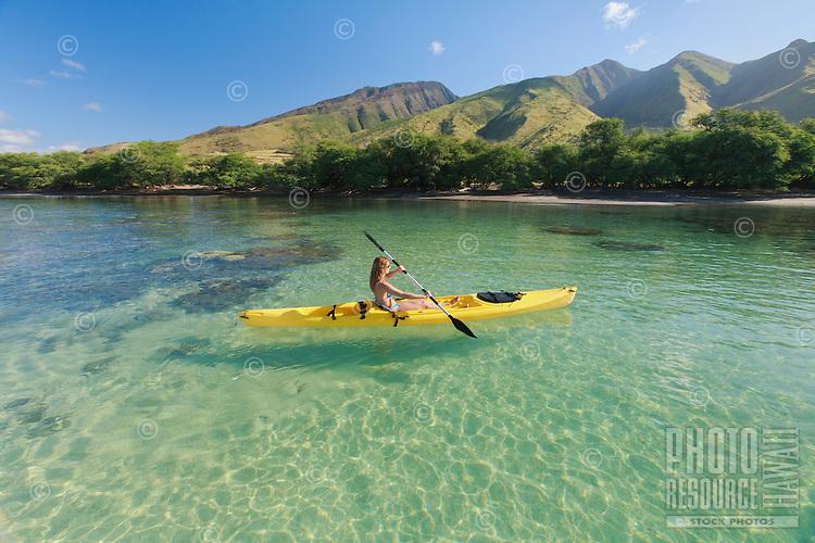A woman kayaks at Olowalu, Maui.