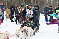 Jim Lanier and team run past spectators on the bike/ski trail near University Lake with an Iditarider in the basket and a handler during the Anchorage, Alaska ceremonial start on Saturday, March 7 during the 2020 Iditarod race. Photo © 2020 by Ed Bennett/Bennett Images LLC