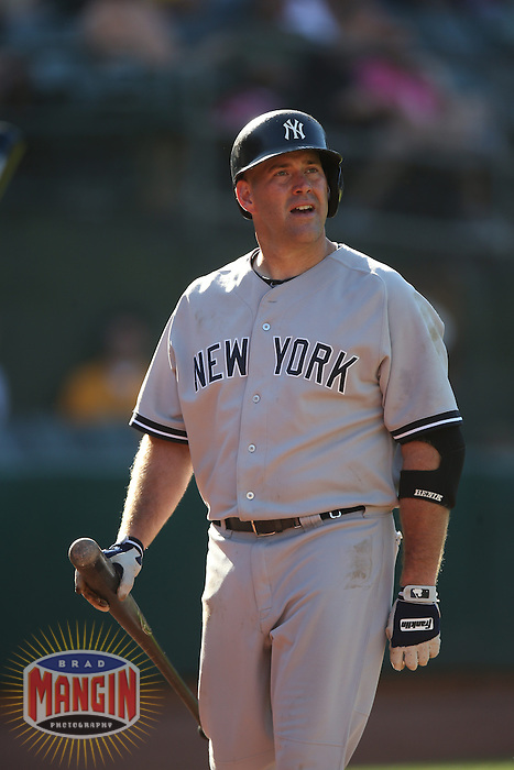 OAKLAND, CA - JUNE 13:  Kevin Youkilis #36 of the New York Yankees walks back to the dugout after striking out against the Oakland Athletics during the game at O.co Coliseum on Thursday June 13, 2013 in Oakland, California. Photo by Brad Mangin