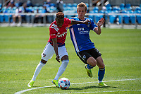 SAN JOSE, CA - APRIL 24: Jader Obrian #7 of FC Dallas battles for the ball with Jackson Yueill #14 of the San Jose Earthquakes during a game between FC Dallas and San Jose Earthquakes at PayPal Park on April 24, 2021 in San Jose, California.