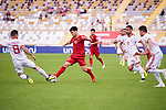 Nguyen Cong Phuong of Vietnam (C) competes for the ball with Morteza Pouraliganji of Iran during the AFC Asian Cup UAE 2019 Group D match between Vietnam (VIE) and I.R. Iran (IRN) at Al Nahyan Stadium on 12 January 2019 in Abu Dhabi, United Arab Emirates. Photo by Marcio Rodrigo Machado / Power Sport Images