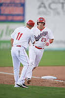 Auburn Doubledays first baseman Chance Shepard (23) is congratulated by manager Jerad Head (11) after hitting a home run during the second game of a doubleheader against the Mahoning Valley Scrappers on July 2, 2017 at Falcon Park in Auburn, New York.  Mahoning Valley defeated Auburn 3-2.  (Mike Janes/Four Seam Images)