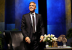George Clooney smiles at the crowd after he was introduced at the Brilliant Lecture Series at the Wortham Theater Thursday May 3,2012. (Dave Rossman Photo)