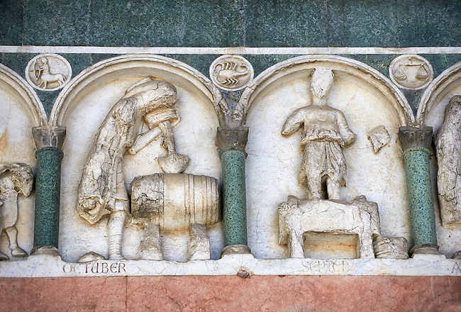 Late medieval relief sculpture depicting the labours for October and september and astrological signs on the Facade of the Cattedrale di San Martino,  Duomo of Lucca, Tunscany, Italy,