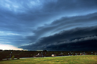 A tiered shelf cloud heralds the approach of a severe thunderstorm's gust front in Richardson Texas. Shelf cloud formations such as these often create wind shears that are extremely hazardous to aircraft