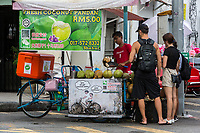 George Town, Penang, Malaysia.  Refreshment Stand Selling Fresh Coconuts.